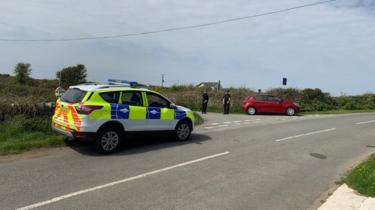 Police at the scene of the incident near South Stack Road