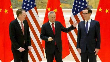 (From L) US Trade Representative Robert Lighthizer, Chinese Vice Premier and lead trade negotiator Liu He and US Treasury Secretary Steven Mnuchin talk before the opening session of trade negotiations at the Diaoyutai State Guesthouse in Beijing on February 14, 2019