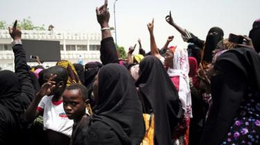 Women at a protest on April 5 gesturing to rally against the government and international forces' failure to tackle rising violence in Mali
