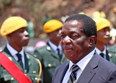 Emmerson Mnangagwa (L) arrives for the burial of liberation war hero Don Muvuti at the national heroes acre in Harare, Zimbabwe, 1 November 2017