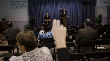 Witnesses discuss the Bible during a Jehovah's Witness meeting in Russia in 2015
