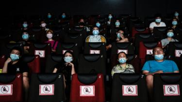 Residents watch a movie in a cinema in Wuhan on July 20, 2020 in Wuhan