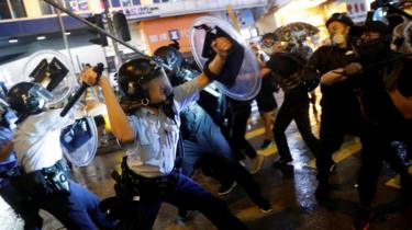 Police clash with anti-extradition bill protesters after a protest