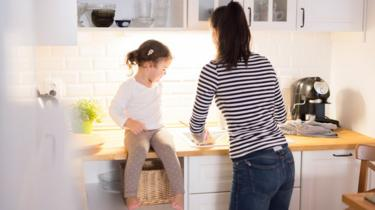 Woman prepares food with her daughter