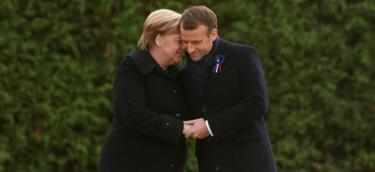French President Emmanuel Macron and German Chancellor Angela Merkel hold hands after unveiling a plaque in the Clairiere of Rethondes during a commemoration ceremony for Armistice Day, 100 years after the end of the First World War, in Compiegne, France, November 10, 2018