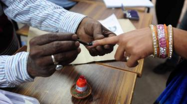 Voter's finger being marked