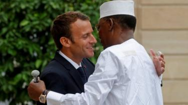 President Macron of France and President Deby of Chad hug in Paris in 2018