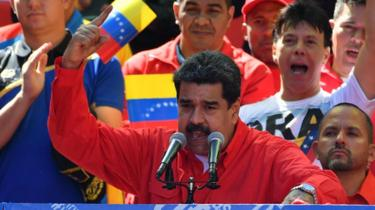 Venezuelan President Nicolas Maduro speaks during a pro-government march in Caracas
