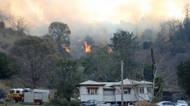Bushfire near a house in the rural town of Canungra in the Scenic Rim region of south-east Queensland, Australia, September 6, 2019