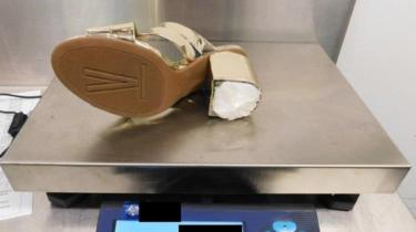 One of Woodrum's shoes on an airport scale