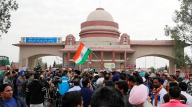 People and media gather before the arrival of Indian Air Force pilot, who was captured by Pakistan on Wednesday, near Wagah border, on the outskirts of the northern city of Amritsar, India, March 1, 2019