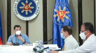 Philippine President Rodrigo Duterte (L), Health Secretary Enrique Duque (R), and Carlito Galvez (C), chief implementer of the National Action Plan against COVID-19, listen over a meeting with members of the inter-Agency Task Force on the Emerging Infectious Diseases (IATF-EID) in Malacanang Palace in Manila on 8 April 2020