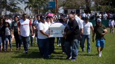 Relatives and friends of a victim of an attack carry a coffin at a funeral in Minatitlan, Veracruz State, Mexico, on April 21, 2019