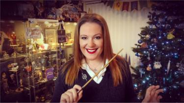 Victoria Maclean in font of some of her Harry Potter memorabilia