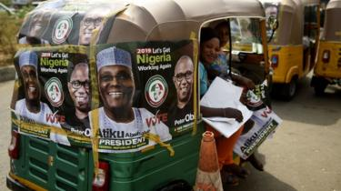Rickshaws emblazoned with campaign posters bearing images of the opposition Peoples Democratic Party election candidate Atiku Abubakar and his running mate Peter Obi stand on a road in Abuja, Nigeria - Monday 19 February 2019