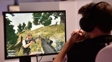 A gamer plays 'PlayerUnknown's Battlegrounds' while competing at an esports tournament