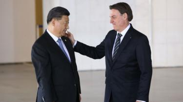 Brazilian president Jair Bolsonaro touches the face of his Chinese counterpart, Xi Jinping, during a November 2019 meeting