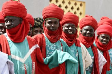 Palace guards dressed in red and green, including large red turbans, stand as candidate of the ruling All Progressives Congress (APC) arrives to pray at Central Mosque, in his native town of Daura in Katsina State, Nigeria - Friday 15 February 2019