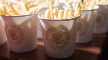 This photo shows French fries placed inside Presidential cups