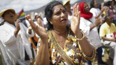 A Hindu woman sings and prays during a mass led by Pope Francis at the Monument of Mary Queen of Peace in Port Louis, Mauritius, 09 September 2019.