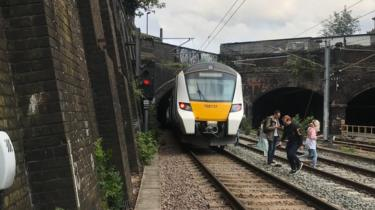 Passengers on a train near Kentish Town station got off and began walking along the tracks