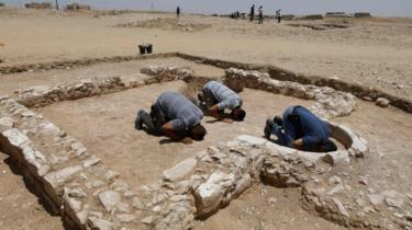 Muslims pray at the site of an ancient mosque in Israel