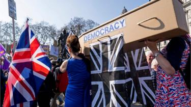 Pro-Brexit demonstrators carry a coffin representing the death of democracy as protesters gather in Parliament Square in central London