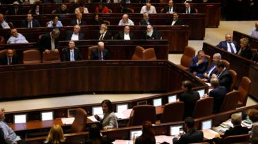 Israeli Prime Minister Benjamin Netanyahu (C-R) and MPs take part in a Knesset(parliament) session in Jerusalem on 26 December 2108