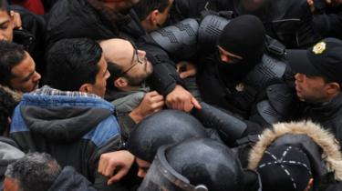Tunisian security forces block access to government offices in scuffles between crowds