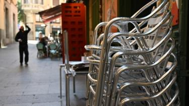 A closed restaurant terrace is pictured in Madrid on 13 March 2020,