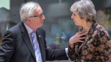 Jean-Claude Juncker and Theresa May (file picture)
