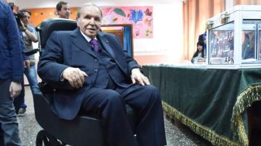 Algerian President Abdelaziz Bouteflika is seen on a wheelchair as he casts his vote at a polling station in 2017