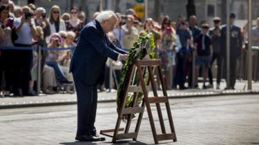 Irish President Michael D Higgins laying a wreath at the Easter Rising commemoration in Dublin