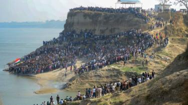 A large number of mourners gather on the bank of the Ganges river to attend the funeral procession for trooper Mahesh Kumar Meena near Allahabad