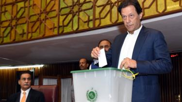 Imran Khan casting his vote for the election of the Speaker of the House, in Islamabad, Pakistan, 15 August 2018.
