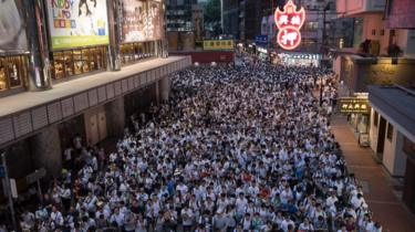 Thousands of protesters take part in a march against amendments to an extradition bill in Hong Kong