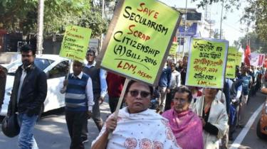 Activists of the Left Democratic Manch alliance hold placards as they take part in protest rally in protest against Citizenship Amendment Bill 2016, which will provide citizenship or stay rights to minorities from Bangladesh, Pakistan and Afghanistan in India, in Guwahati on January 7, 2019.