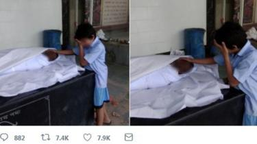 This photo of the worker's 11-year-old son sobbing next to his body went viral.