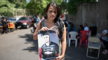 Elizabeth del Rosario Cano Molina holds a picture of her husband