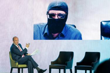 Grigory Rodchenkov appears by videolink at a Foundation for Sports Integrity conference in May 2018