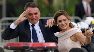 Jair Bolsonaro with his wife Michelle in a presidential convoy