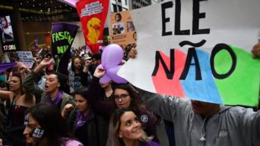 Demonstrators take part in a women protest against Brazilian right-wing presidential candidate Jair Bolsonaro called by a social media campaign under the hashtag #EleNao (Not Him) in Sao Paulo, Brazil, on October 6, 2018.