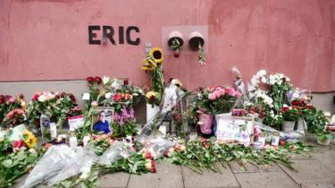 Flowers, candles and cards placed at the scene of the shooting for Eric Torell's memorial