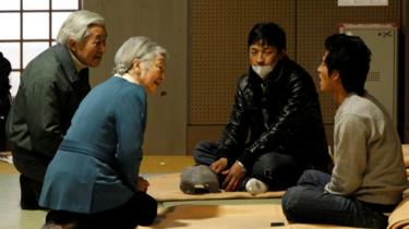 Japan's Emperor Akihito and Empress Michiko talk with evacuees from the March 11 earthquake and tsunami at Tokyo Budoh-kan