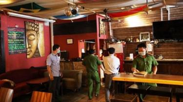 Police check the Buddha Bar after it was cleared to reopen