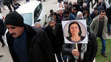 """A supporter of pro-Kurdish Peoples"""" Democratic Party (HDP) holds a picture of jailed lawmaker Leyla Guven, during a demonstration in solidarity with her, in Diyarbakir, Turkey January 12, 2019"""