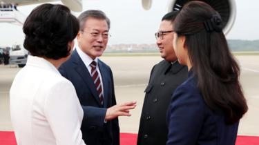 Kim Jung-sook, Ri Sol-ju, Moon Jae-in and Kim Jong-un embrace at the airport