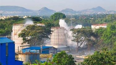 Smokes rise from an LG Polymers plant following a gas leak incident in Visakhapatnam on May 7, 2020. -