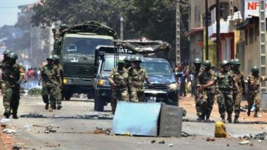Protesters confront the army in the streets in Conakry on 22 March, during a constitutional referendum in the country