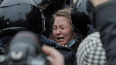 Russian special police units officers detain a protester during an unauthorized protest in support of Russian opposition leader